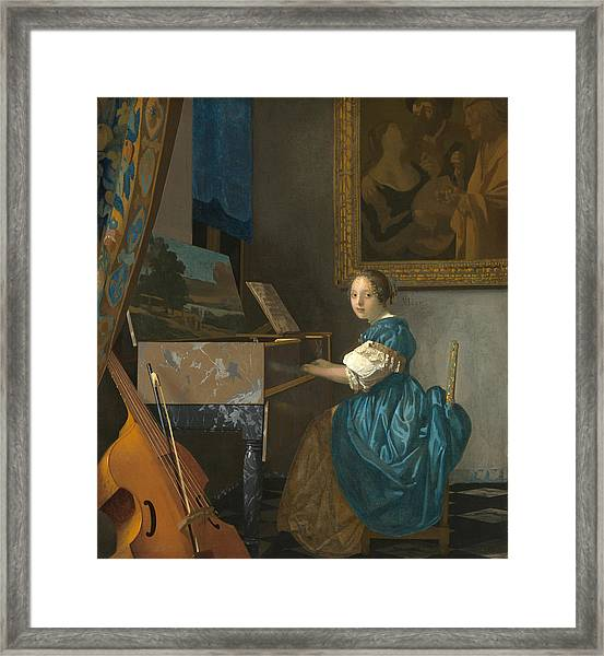 Lady Seated At A Virginal Framed Print