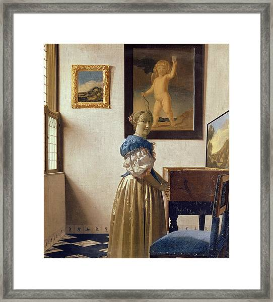 Lady Standing At The Virginal Framed Print