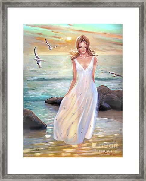 Lady Walking On The Beach Framed Print