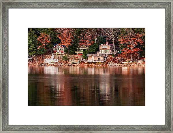 Lake Cottages Reflections Framed Print