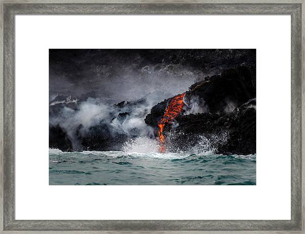 Lava Dripping Into The Ocean Framed Print