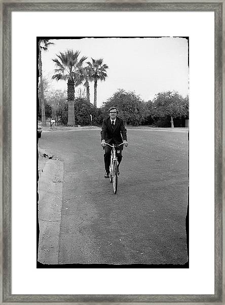 Lawyer On A Bicycle, 1971 Framed Print