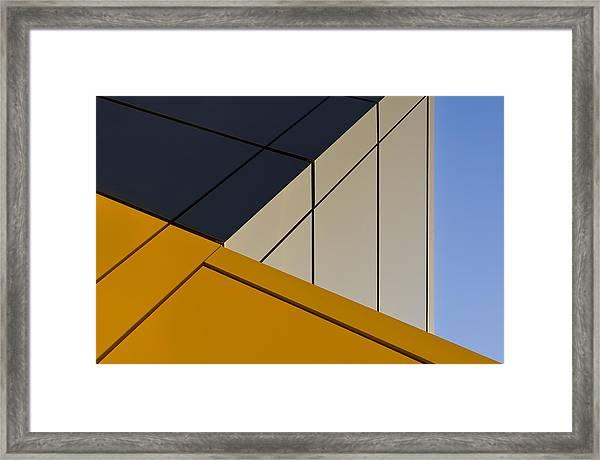 Leaning Against The Blue Sky Framed Print