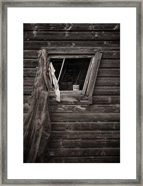 Leaning Window Framed Print