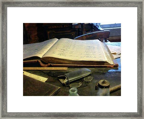 Ledger And Eyeglasses Framed Print