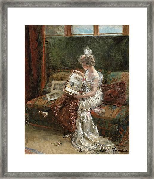 Leonie Garrido Looking At An Album Of Prints Framed Print