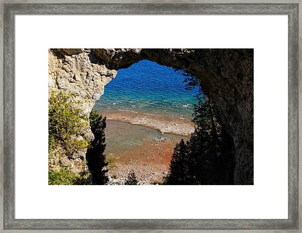Life Below Arch Rock Framed Print