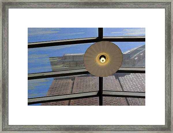 Light On A Dirty Glass Ceiling In Tacoma Washington Framed Print