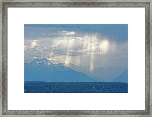 Light Through Clouds Framed Print