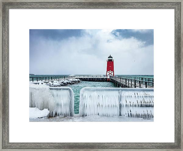 Lighthouse And Ice Framed Print
