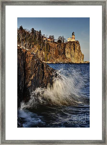 Lighthouse And Spray Framed Print
