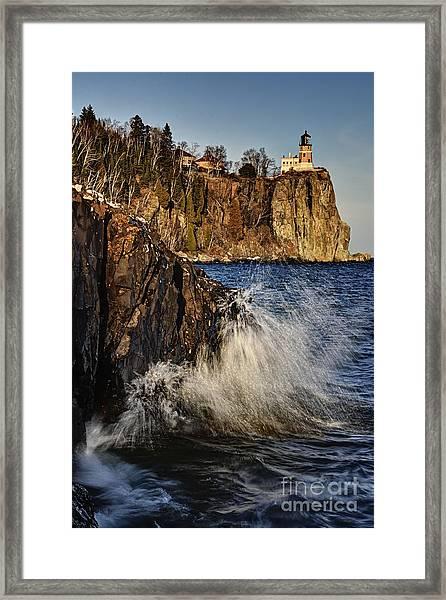 Lighthouse And Spray Framed Print