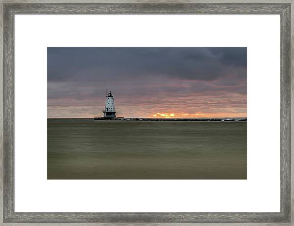 Lighthouse And Sunset Framed Print