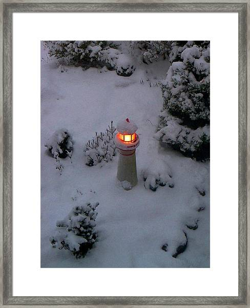 Lighthouse In The Snow Framed Print