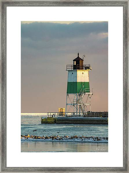 Lighthouse In The Sunset Framed Print