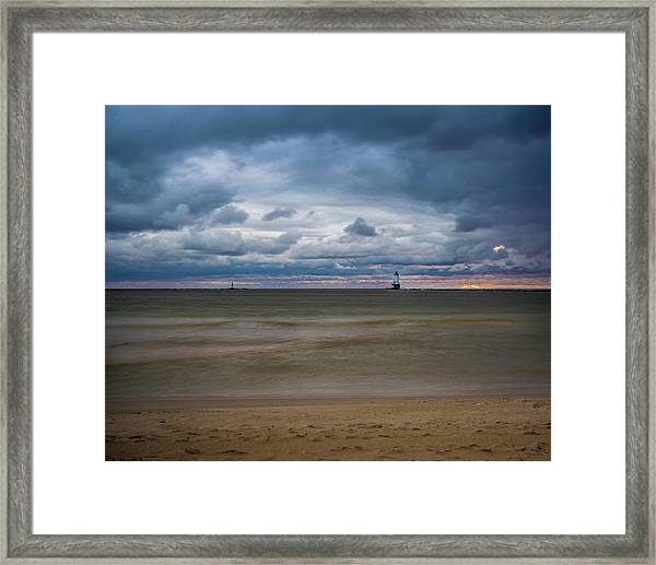 Lighthouse Under Brewing Clouds Framed Print