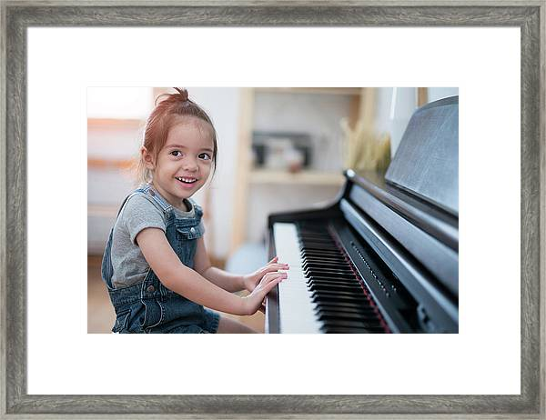 Little Girl Play Piano And Sing A Song In Living Room