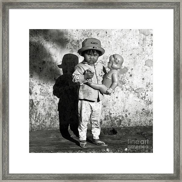 Little Vietnamese Girl Playing With Her Doll Framed Print