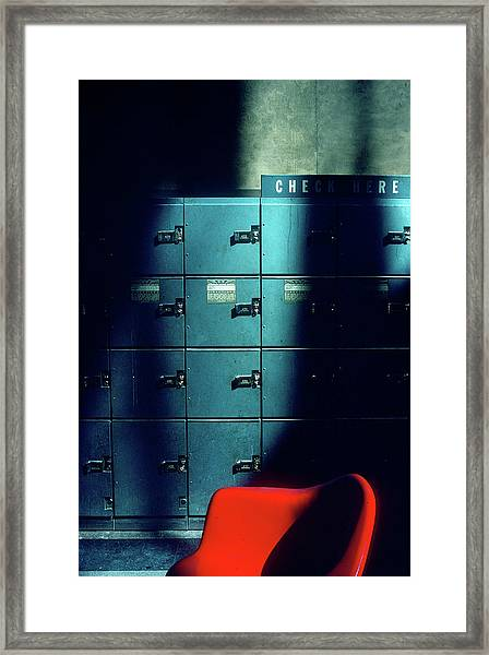 Lockers And Red Chair Framed Print