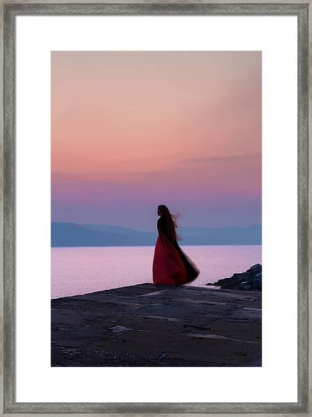 Lone Figure On The Cob, Lyme Regis, Dorset, Uk, At Sunrise. Framed Print