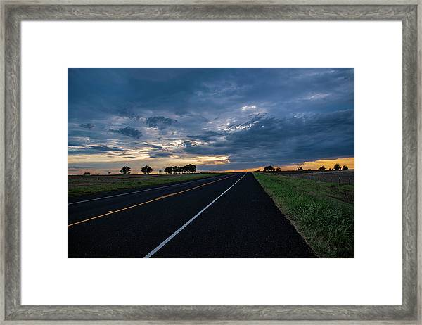 Lone Highway At Sunset Framed Print