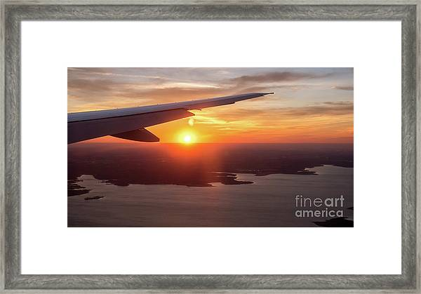 Looking At Sunset From Airplane Window With Lake In The Backgrou Framed Print