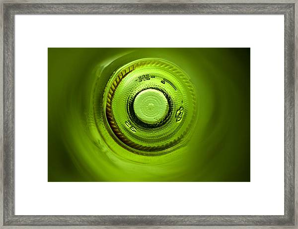 Looking Deep Into The Bottle Framed Print