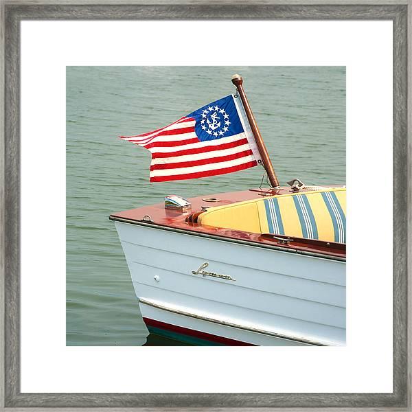 Vintage Mahogany Lyman Runabout Boat With Navy Flag Framed Print