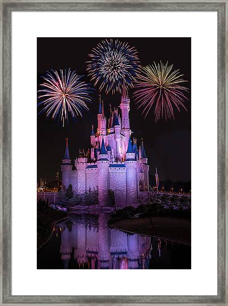 Magic Kingdom Castle Under Fireworks Framed Print