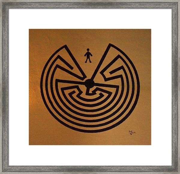 Man In Maze Framed Print