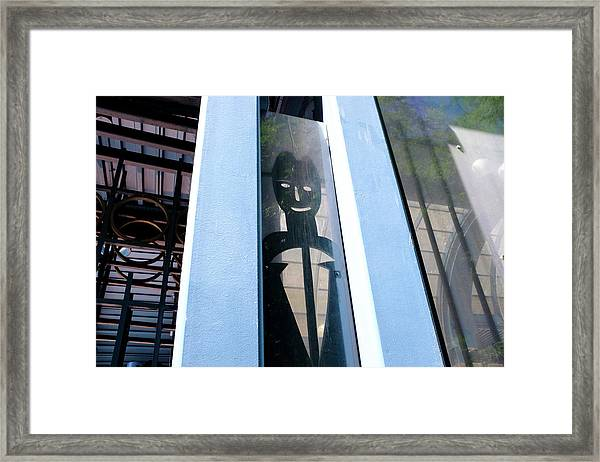Man Looking At You Through A Window In Seattle Washington Framed Print