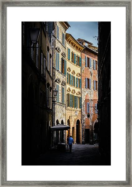 Man Walking Alone In Small Street In Siena, Tuscany, Italy Framed Print