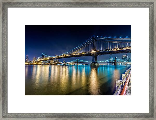 Manhattan And Brooklyn Bridges At Night. Framed Print