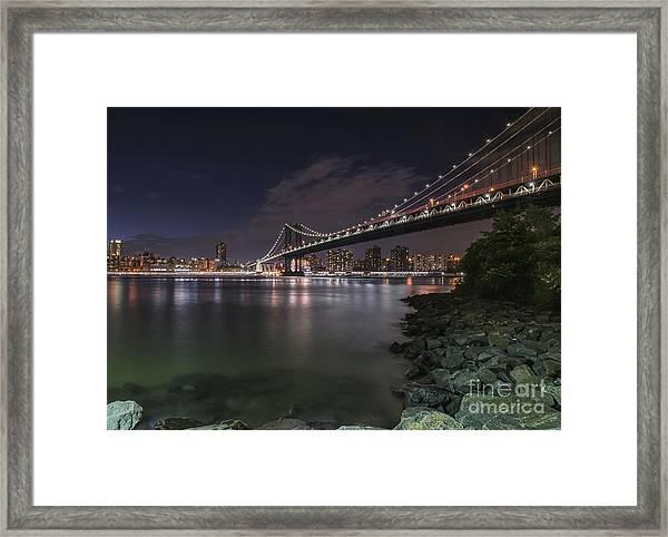 Manhattan Bridge Twinkles At Dusk Framed Print