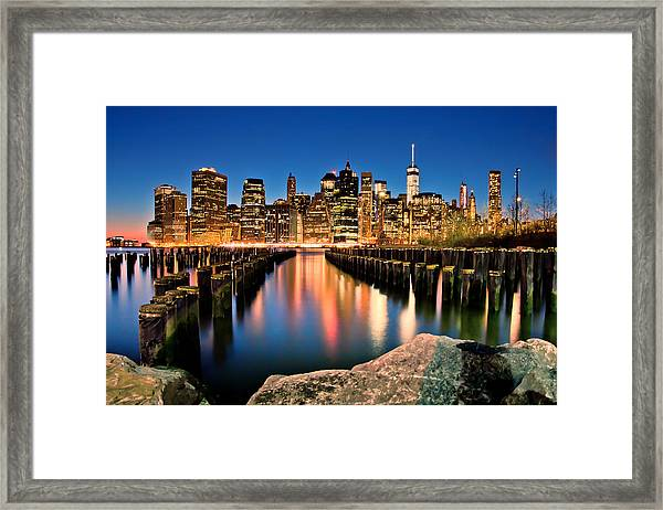 Manhattan Skyline At Dusk Framed Print