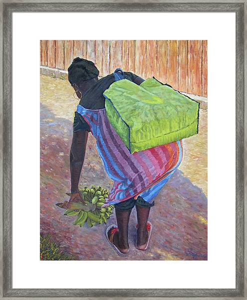 Woman At Her Chores Framed Print