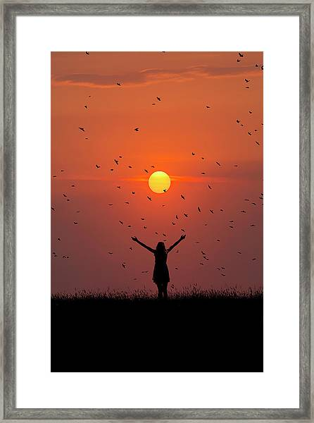 Silhouette Of Girl On Brow Of Hill At Sunset Framed Print
