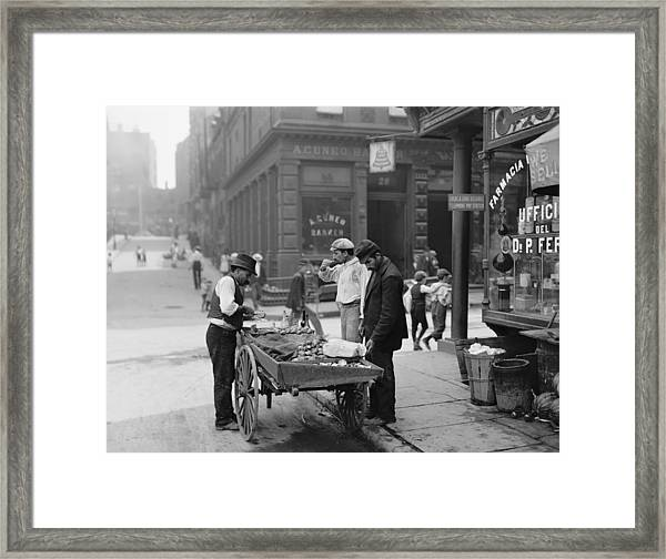Men Eating Fresh Clams From A Pushcart Framed Print