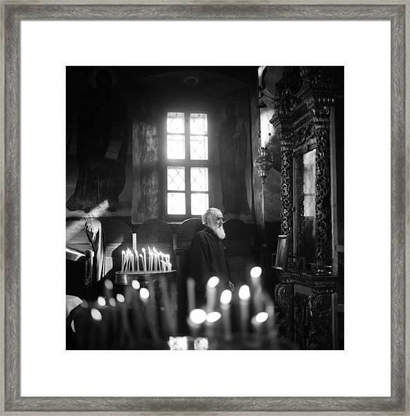 Monk And Candles Framed Print