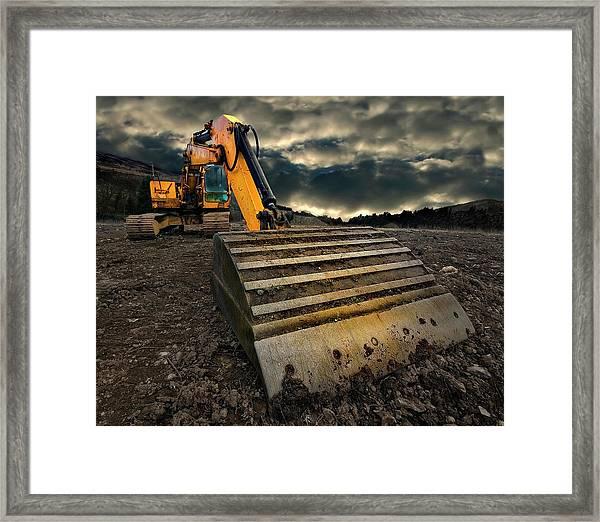 Moody Excavator Framed Print