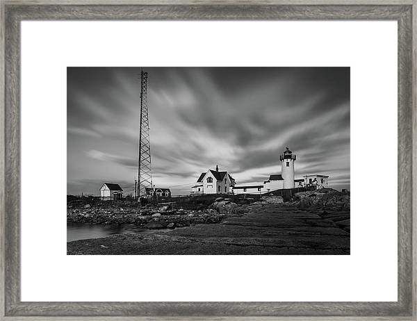 Moody Sky At Eastern Point Lighthouse Framed Print