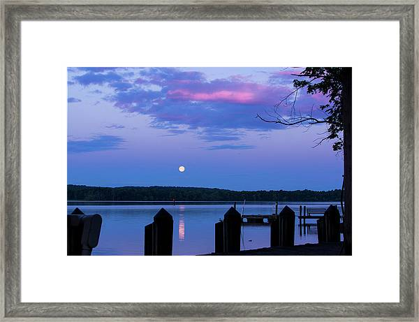 Moon And Pier Framed Print