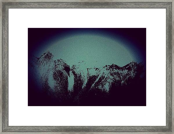 Moon In The Mountains Framed Print