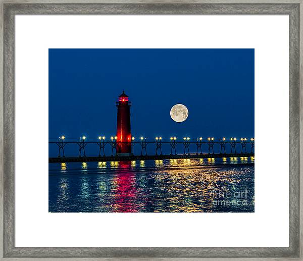 Moon Over Grand Haven Framed Print