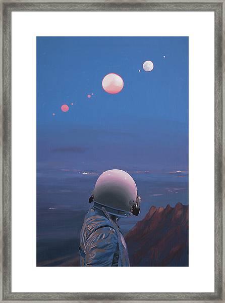 Moons Framed Print