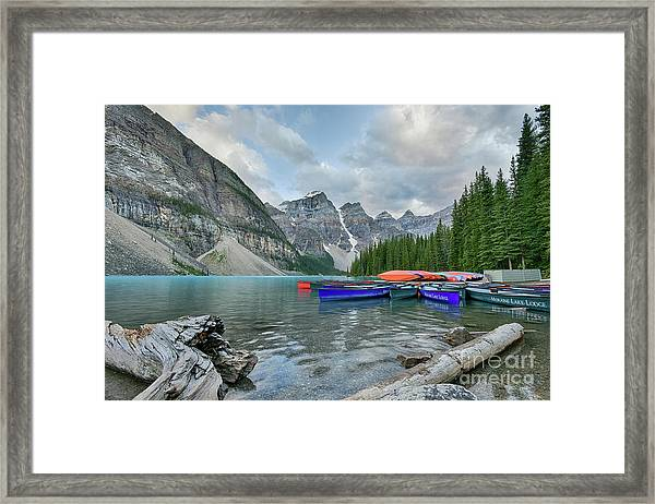 Moraine Logs And Canoes Framed Print