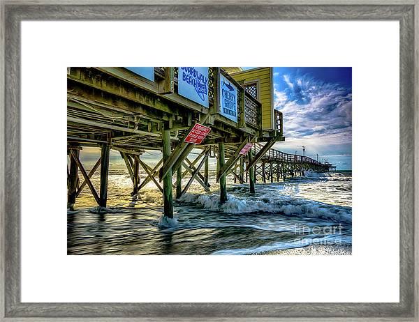 Morning Sun Under The Pier Framed Print