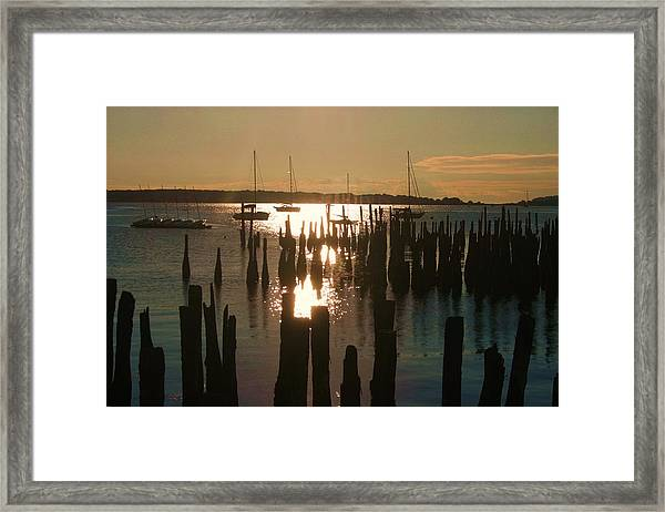 Morning Sunrise Over Bay. Framed Print by Dennis Curry