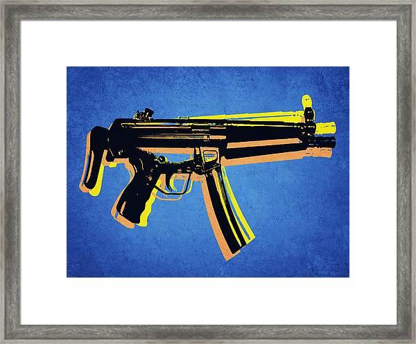 Mp5 Sub Machine Gun On Blue Framed Print by Michael Tompsett
