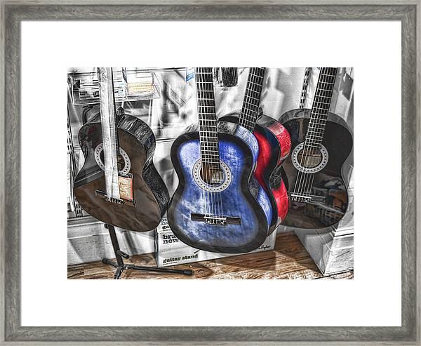 Muted Guitars Framed Print
